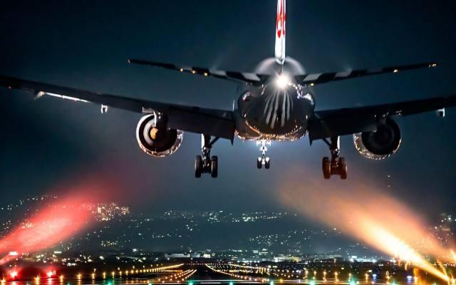 the plane, landing, the city, evening