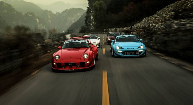 Supercars, road, mountains