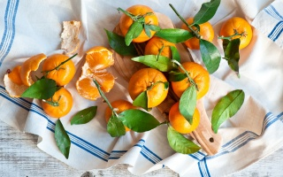 tangerines, leaves, towel