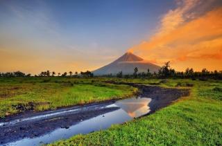 sunset sky, mountain, trees, grass, water