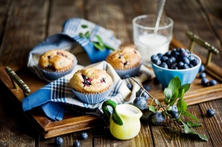 cupcakes, blueberries, pitcher with cream, towel, milkshake.