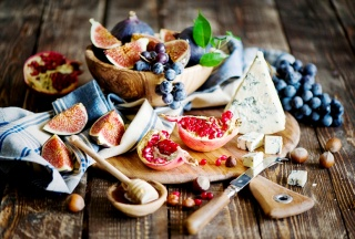 grapefruit, garnet, hazelnut, cheese, grapes, towel, knife, cutting Board