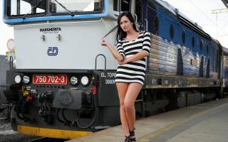 Tess Lyndon, train, station, platform, tunic, striped