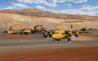 theme, quarry, development, iron ore deposits, South Africa, the plane, the rise, excavators, trucks, the sky, clouds