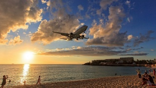the plane, the sky, the beach, people