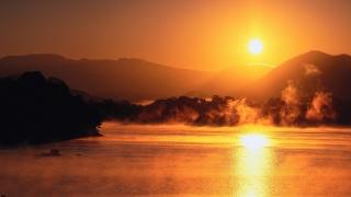 the sun, mountains, fog, sea