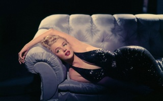 Marilyn Monroe, singer, actress, lying, posing, the dark background