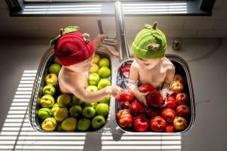 children, boy, girl, a couple, beanie, sink, fruit, apples