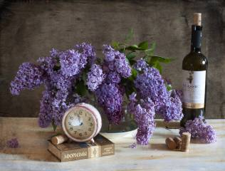 branches, lilac, bottle, tube, book, watch, alarm clock