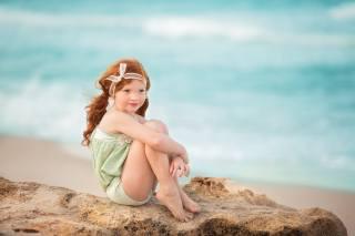 sandra bianco, child, girl, red, tails, tape, stone, shore