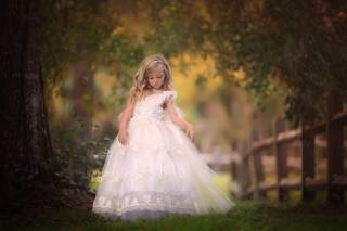 sandra bianco, child, girl, blonde, curls, dress, outfit, nature, summer, trees, branches, leaves, the fence