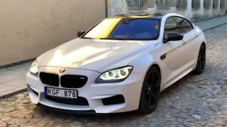 Автомобиль BMW M6 седан, белый