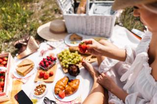 berries, strawberry, croissant, picnic, hands, blurred background, food